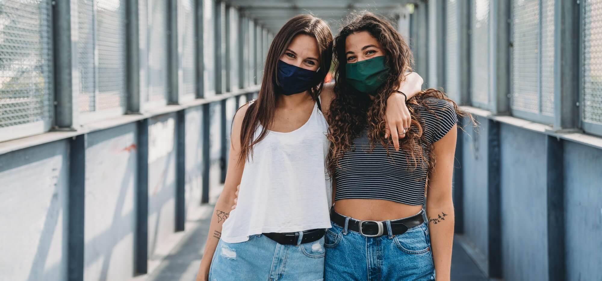girls wearing masks